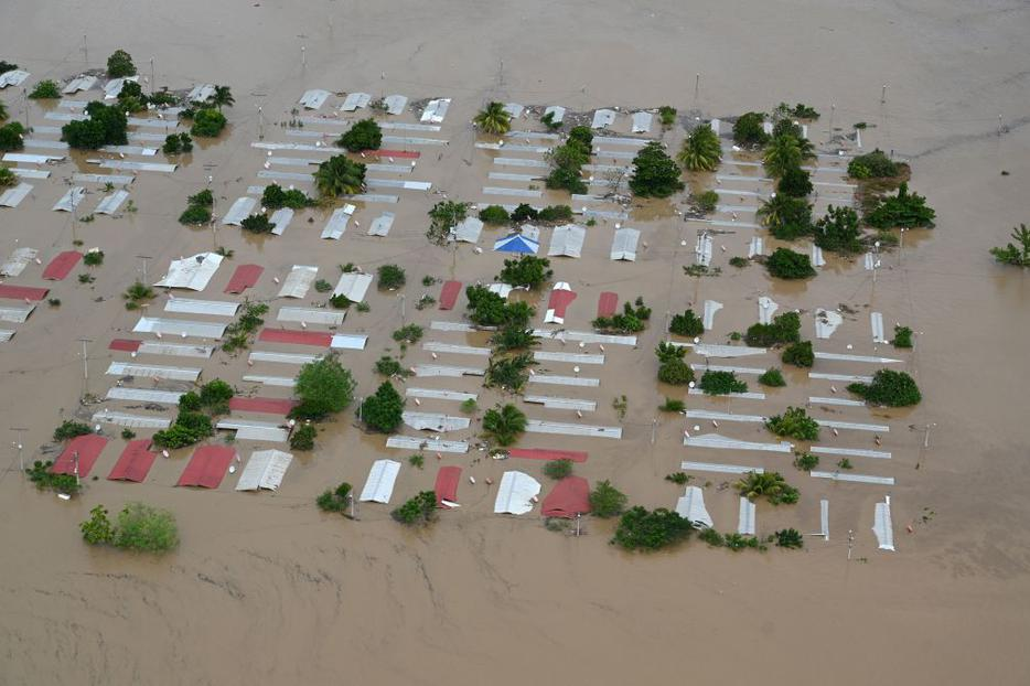 Aerial view an area around San Pedro Sula, 240 km north of Tegucigalpa, flooded by the overflowing of the Chamelecon river after the passage of Hurricane Iota, taken on November 18, 2020.