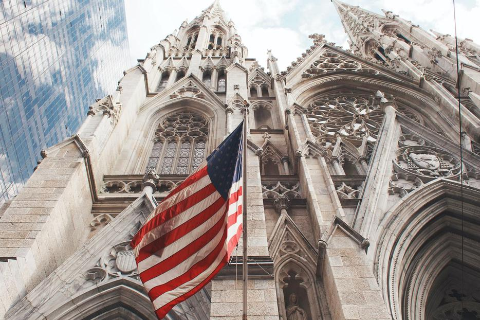 An American flag waves outside of St. Patrick's Cathedral in Manhattan.