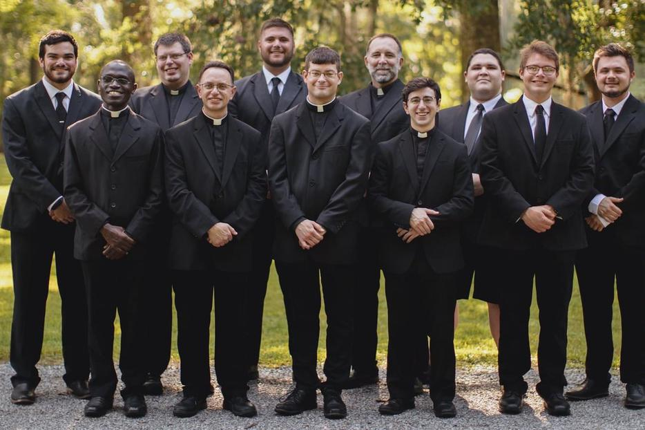 Chad Chermaie Jr., shown in the back row, third from left, along with seminarians from the Diocese of Diocese of Houma-Thibodaux, Louisiana, is pursuing his vocation after many years of much focus on football.