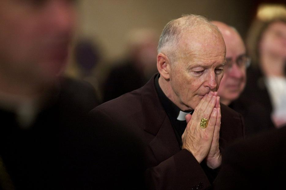 "Archbishop of Washington Theodore Cardinal McCarrick prays during a prayer for deceased bishops November 11, 2002 at the start of the morning session of the US Conference of Catholic Bishops being held in the Capitol Hyatt in Washington, DC. The US Conference of Catholic Bishops met to revise its policy on pedophile priests after the Vatican rejected their first ""zero tolerance"" recommendation to dismiss any one accused of such crimes."