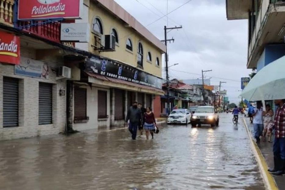 Streets flooded in Lima Nueva Cortes  after two Category 4 storms hit the island.