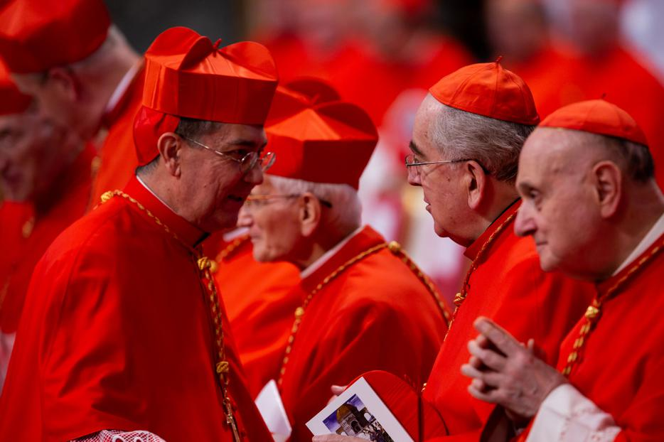 Cardinal Miguel Angel Ayuso Guixot (Left), President of the Pontifical Council for Interreligious Dialogue, after receiving the red biretta from Pope Francis during an Ordinary Public Consistory for the Creation of New Cardinals in St. Peter's Basilica on Oct. 5, 2019.