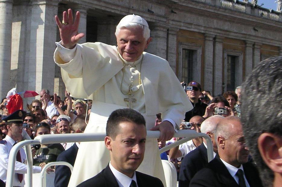 Paolo Gabriele rides in front of Pope Benedict XVI in 2005.