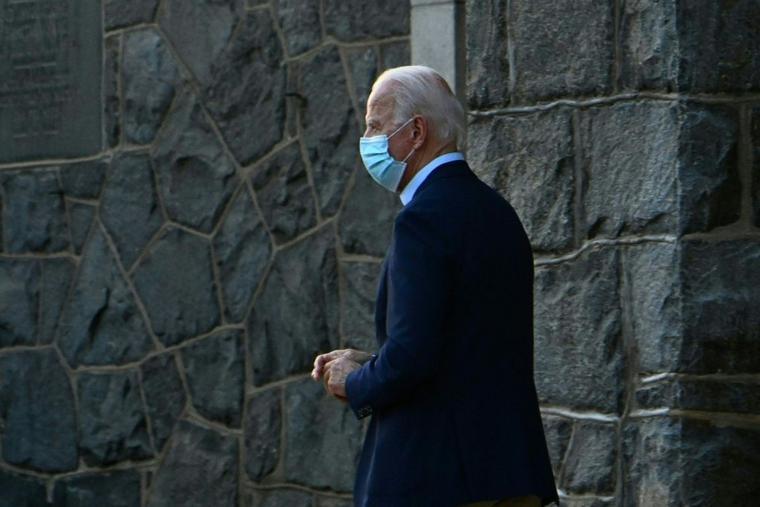 Joe Biden leaves after attending Mass at St. Ann Catholic Church on Nov. 21 in Wilmington, Delaware.