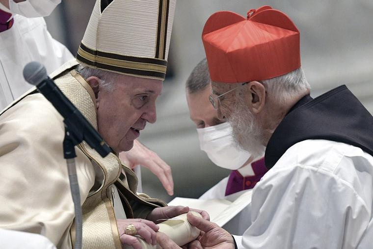 Cardinal Raniero Cantalamessa receives the red hat from Pope Francis on Nov. 28, 2020.