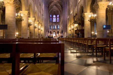 Empty chairs inside the Notre Dame Cathedral.