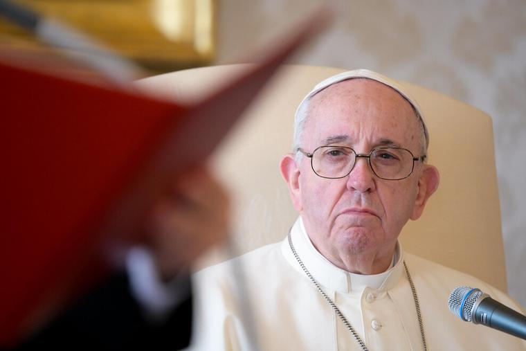 Pope Francis livestreamed the Wednesday general audience from the library of the Vatican's Apostolic Palace, Nov. 11, 2020, without an audience as a precaution during an increase in coronavirus cases in Italy.