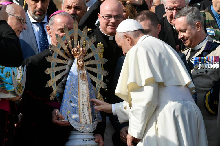 Pope Francis touches a statue of Our Lady of Lujan after the Wednesday general audience in St. Peter's Square on Oct. 30, 2019.