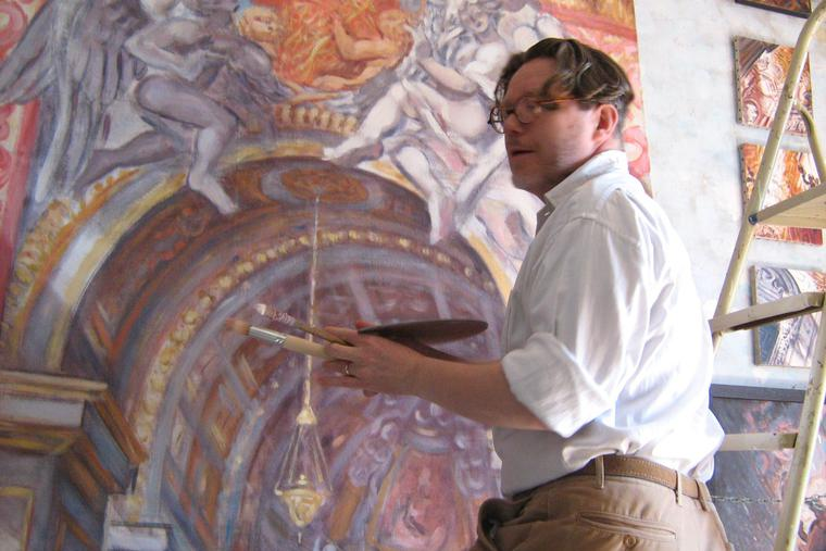 Philippe Casanova works on a painting.
