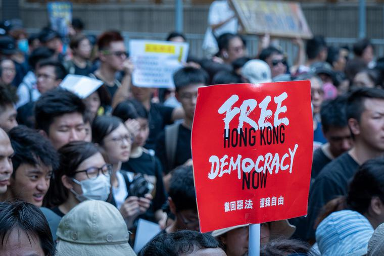 Protesters march in Sha Tin against Hong Kong's extradition bill in June 2019