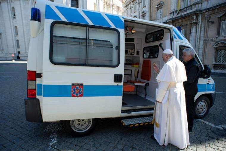 Pope Francis blesses an ambulance entrusted to the Office of Papal Charities.