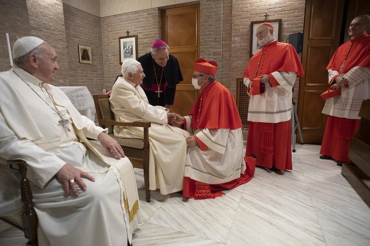 Pope Benedict XVI greets new cardinals on Nov. 28, 2020