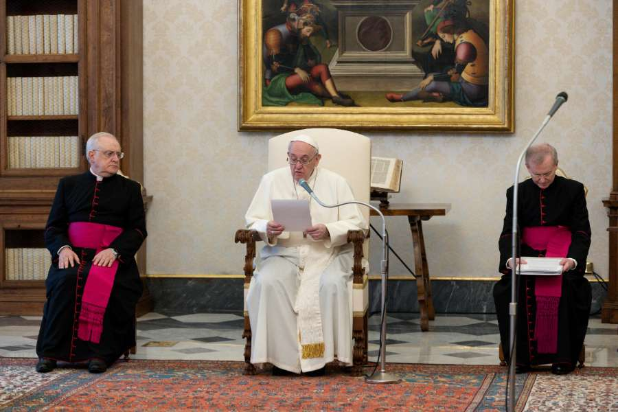 Pope Francis speaks during a general audience in the library of the Apostolic Palace.