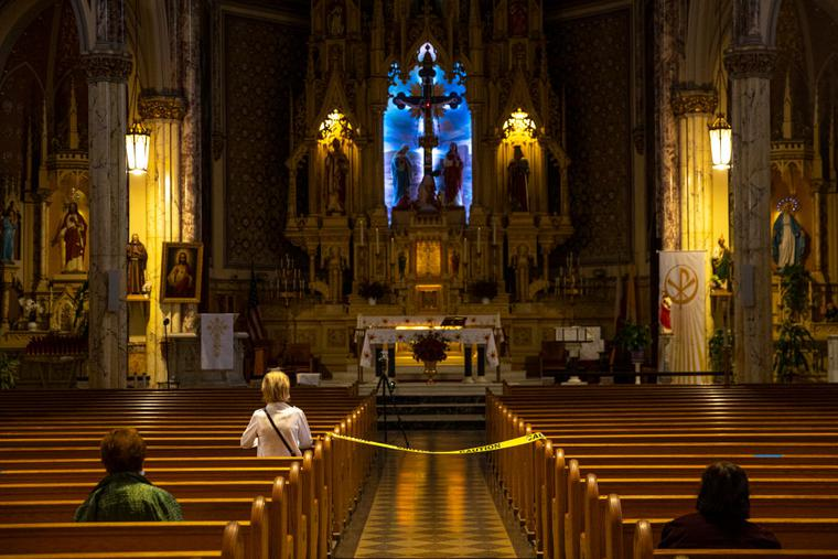 Church goers pray keeping social distancing at the St. Sanislaus Kostka Catholic Church  in the Greenpoint neighborhood of Brooklyn, New York on June 11, 2020.