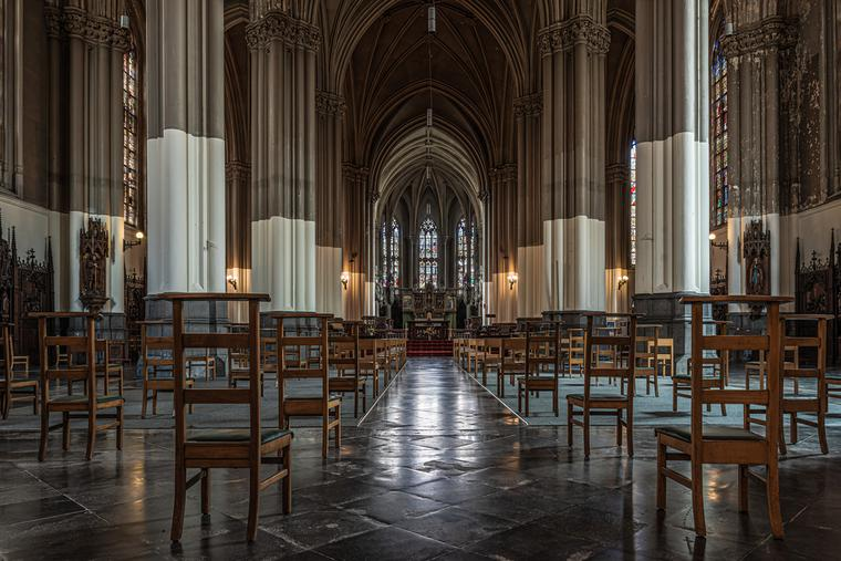 Brussel's Saint Boniface Catholic church interior with chairs and social distancing.