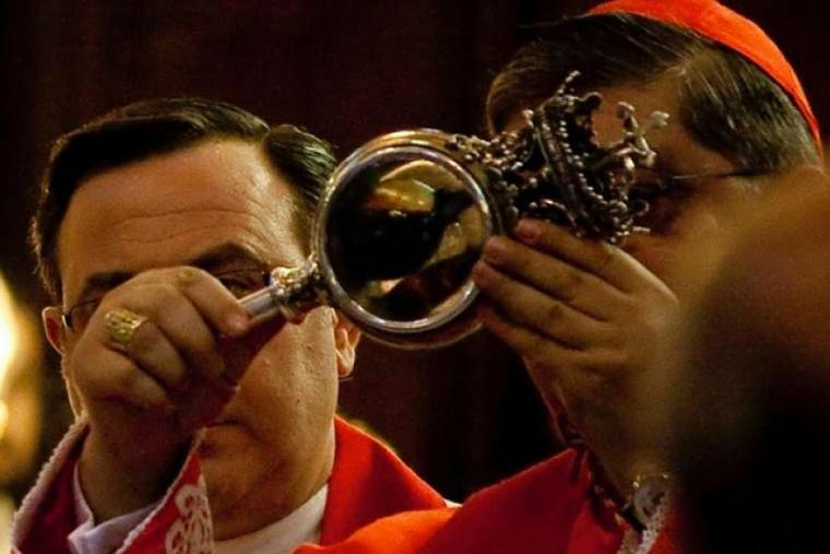 Cardinal Crecscenzio Sepe views the reliquary with the blood of St. Januarius in 2009.