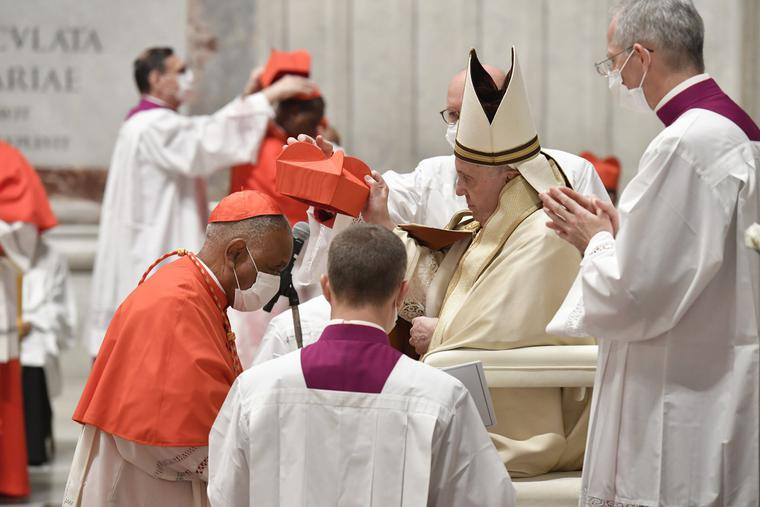 Cardinal Wilton Gregory receives the red hat from Pope Francis in St. Peter's Basilica on Nov. 28.
