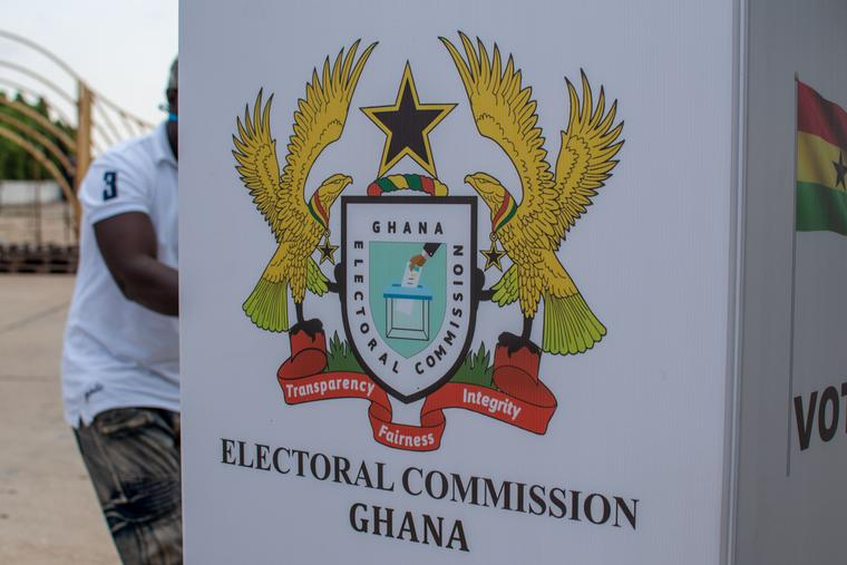 A man votes behind the privacy of a voting booth in an election in Accra, Ghana.