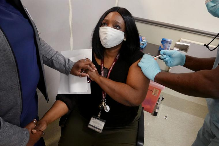 Latrice Davis, a nurse at Roseland Community Hospital, receives the COVID-19 vaccine on December 18, 2020 in Chicago, Illinois.