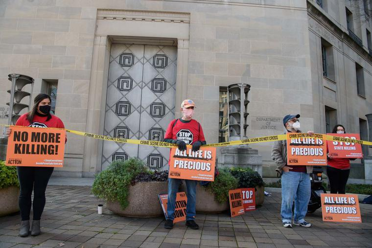 Demonstrators protest federal executions of death row inmates, in front of the US Justice Department in Washington, DC, on December 10, 2020.