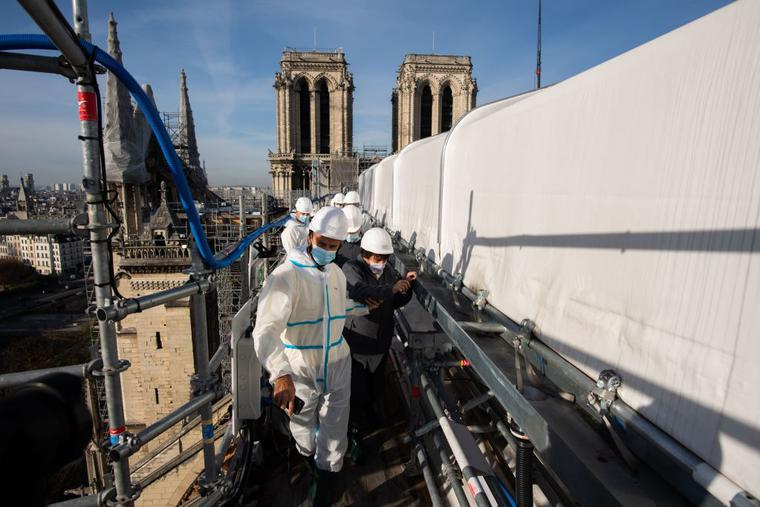 French Culture minister Roselyne Bachelot (1st-R) visits the reconstruction site of Notre-Dame cathedral in Paris, on November 24, 2020.