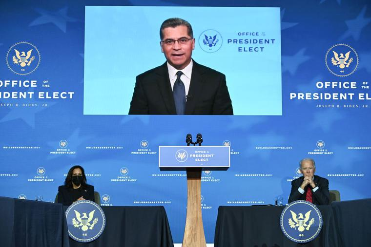 California Attorney General Xavier Becerra, who has been nominated by Biden to serve as secretary of Health and Human Services, speaks as President-elect Joe Biden (R) and Vice-President-elect Kamala Harris (L) look on as Biden announces his team tasked with dealing with the Covid-19 pandemic at The Queen in Wilmington, Delaware on December 8, 2020.