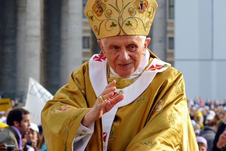 Pope Benedict XVI arrives for a canonization ceremony in St. Peter's Square, Oct. 24, 2011.