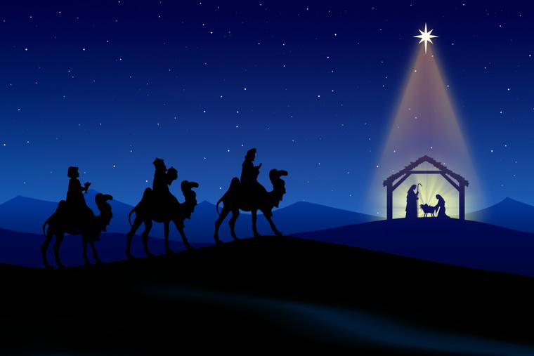 The three wise following the star to the baby Jesus.