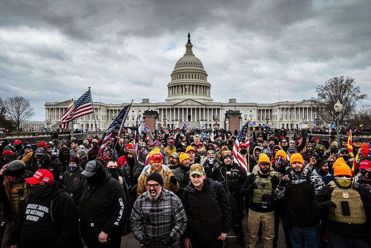 Trump supporters gather in front of the U.S. Capitol Building on January 6, 2021 in Washington, DC. where a pro-Trump mob stormed the Capitol, breaking windows and clashing with police officers. At least, one person died in the clash.