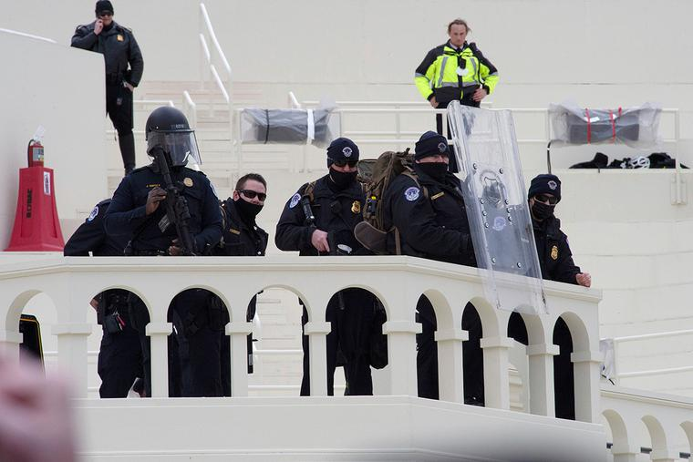Police stand guard at the U.S. Capitol Building on Wednesday afternoon.