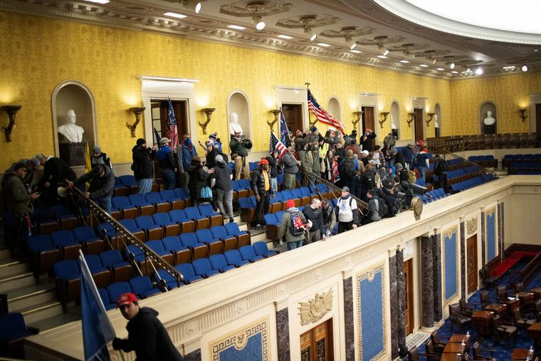 Just minutes after lawmakers were evacuated, a pro-Trump mob gathers inside the Senate chamber in the U.S. Capitol after groups stormed the building on Jan. 6 in Washington, D.C.
