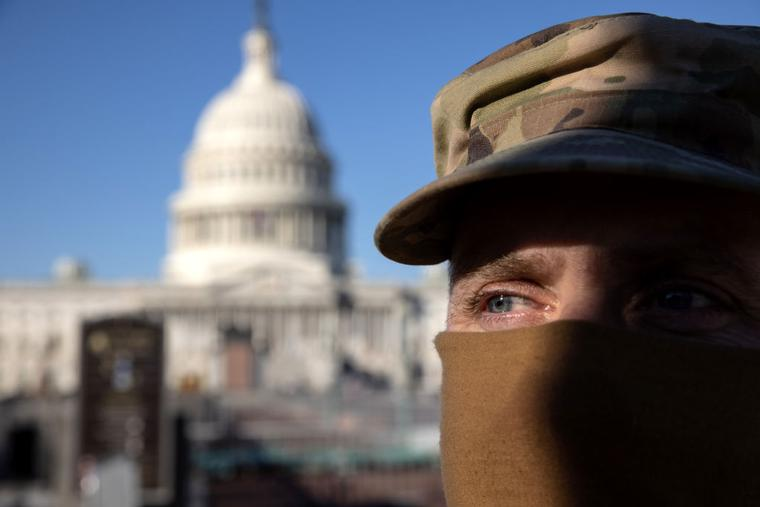 National Guard Sgt. Allan Gilbreath stands guard outside the east side of the U.S. Capitol on January 07, 2021 in Washington, DC.