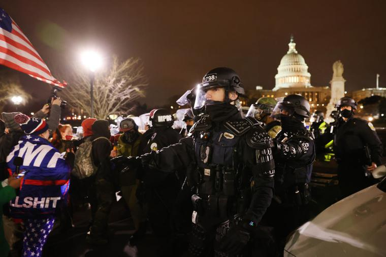 "Members of the National Guard and the Washington D.C. police keep a small group of demonstrators away from the Capital after thousands of Donald Trump supporters stormed the United States Capitol building following a ""Stop the Steal"" rally on January 06, 2021 in Washington, DC."