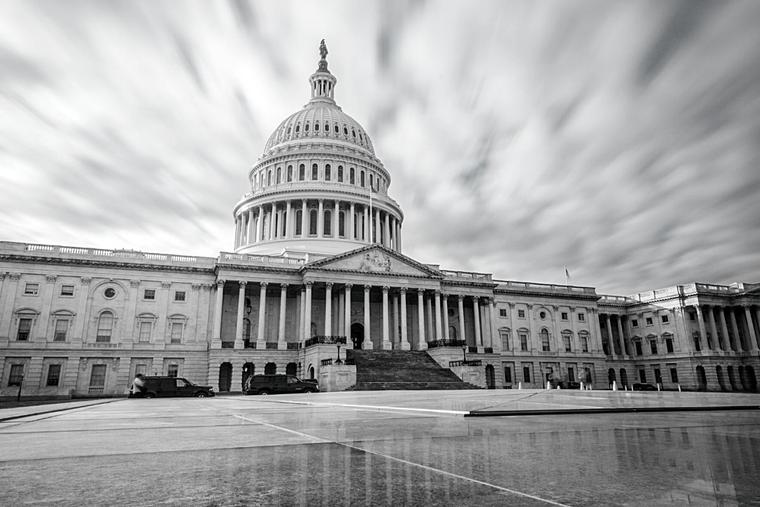 U.S. Capitol building in black and white.