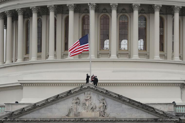 The American flag is lowered to half-staff atop the U.S. Capitol Building following the death of a U.S. Capitol Police Officer on January 08, 2021 in Washington, DC. The officer died after he was injured when a pro-Trump mob stormed and entered the Capitol Building on Wednesday.