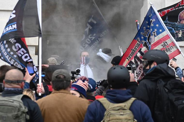Trump supporters are tear gassed outside the U.S. Capitol in Washington on Jan. 6. Demonstrators breeched security and entered the Capitol as Congress debated the 2020 presidential election Electoral College vote certification.