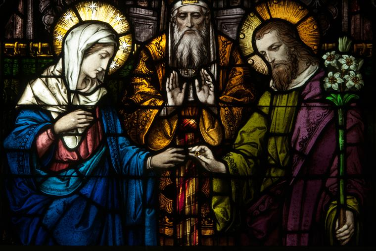 Above, a stained-glass window depicts the betrothal of Mary and Joseph in the Church of the Immaculate Conception in Connellsville, Pennsylvania.