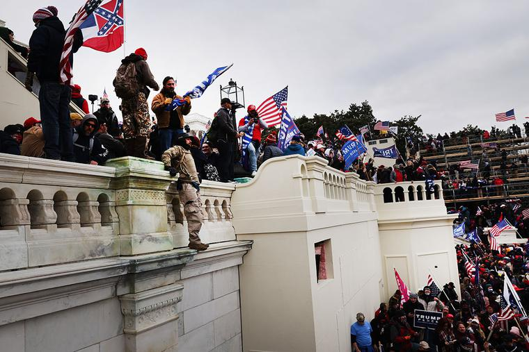 """Thousands storm the United States Capitol building following a """"Stop the Steal"""" rally on Jan. 6, 2021, in Washington, DC."""