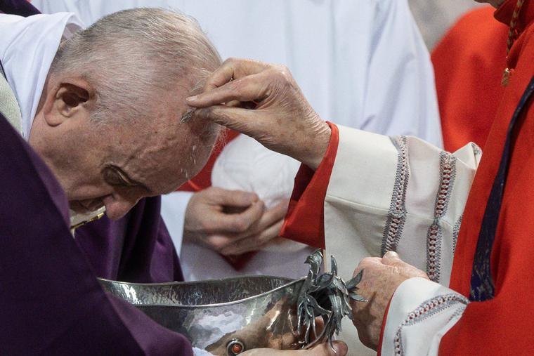 Pope Francis receives ashes on his head during Ash Wednesday in Rome, Feb. 26, 2020.