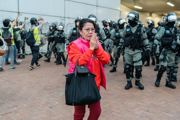 """Police shut down the """"Stand with Uyghurs"""" rally at Edingburgh Place in Hong Kong."""