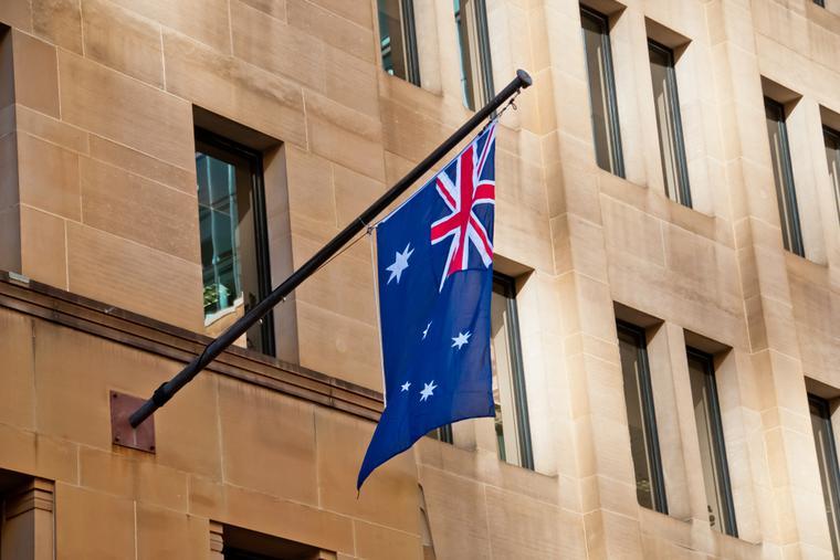 Australian flag hangs from side of building in Sydney.