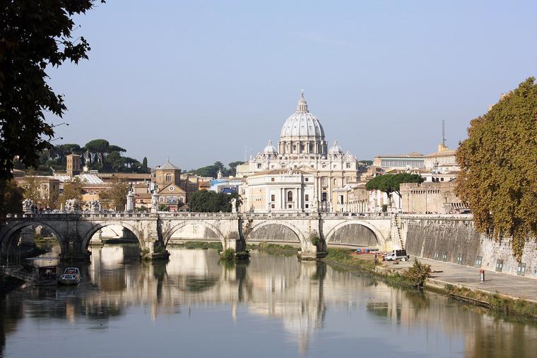 St. Peter's Basilica is seen across the Tiber River.