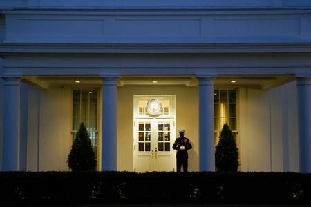 A Marine stands outside the West Wing of the White House at dusk after the U.S. House of Representatives voted to impeach U.S. President Donald Trump on January 13, 2021 in Washington, DC. President Trump is the first president in United States history to face impeachment twice. (Photo by Drew Angerer/Getty Images)