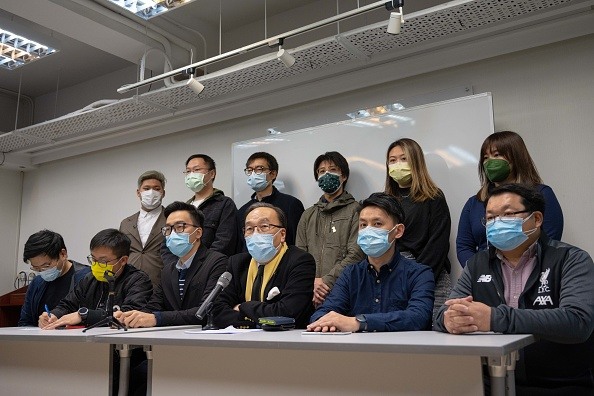 Chairman of the Civic Party Alan Leong (front center) and other members  speaks during a pnews conference on Jan. 6 in Hong Kong. More than 50 Hong Kong opposition figures were arrested under the national security law, deepening a crackdown that the bishop emeritus has spoken out against.