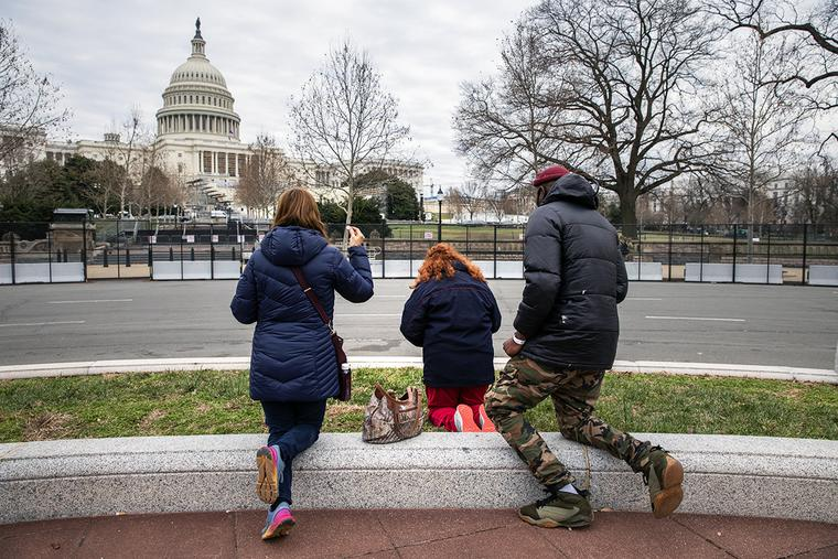 A group prays for peace outside the U.S. Capitol on Jan. 8 in Washington, D.C.