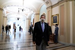 U.S. Sen. Joe Manchin, D-WV, wears a protective mask as he departs the U.S. Capitol on September 21, 2020 in Washington, DC.