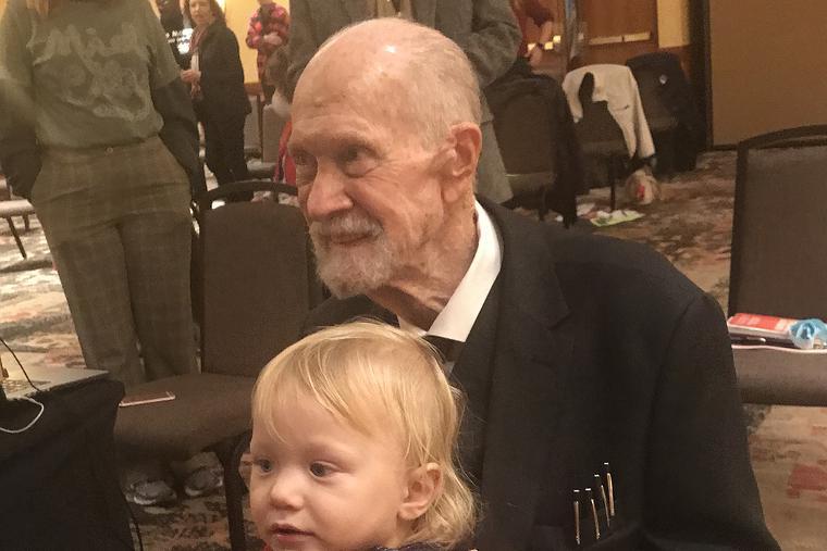 Pro-life legend Joe Scheidler holds his great-granddaughter in 2020.