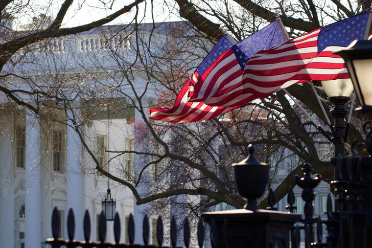 Flags fly outside the White House in Washington, D.C.
