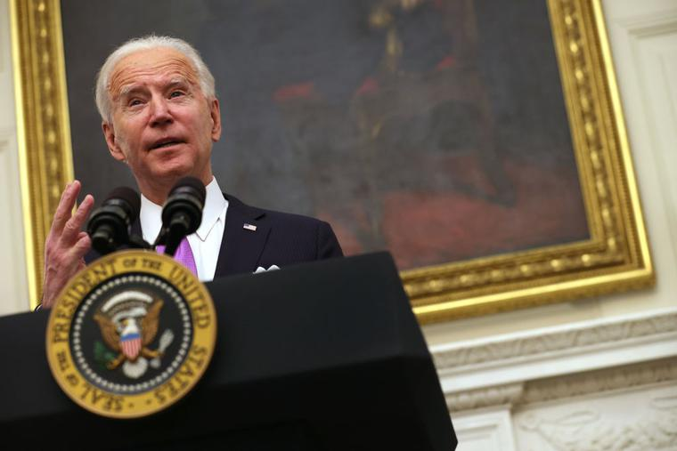 U.S. President Joe Biden speaks during an event in the State Dining Room of the White House January 21, 2021 in Washington, DC.