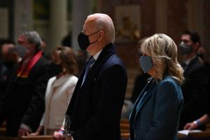 President-elect Joe Biden (C) and incoming First Lady Jill Biden attend Mass at the Cathedral of St. Matthew the Apostle in Washington, DC, on January 20, 2021.